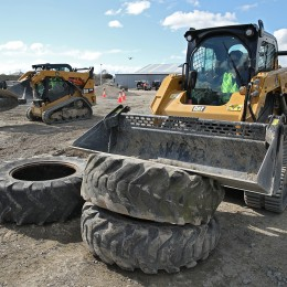 Stacking up tyres with a front-end loader